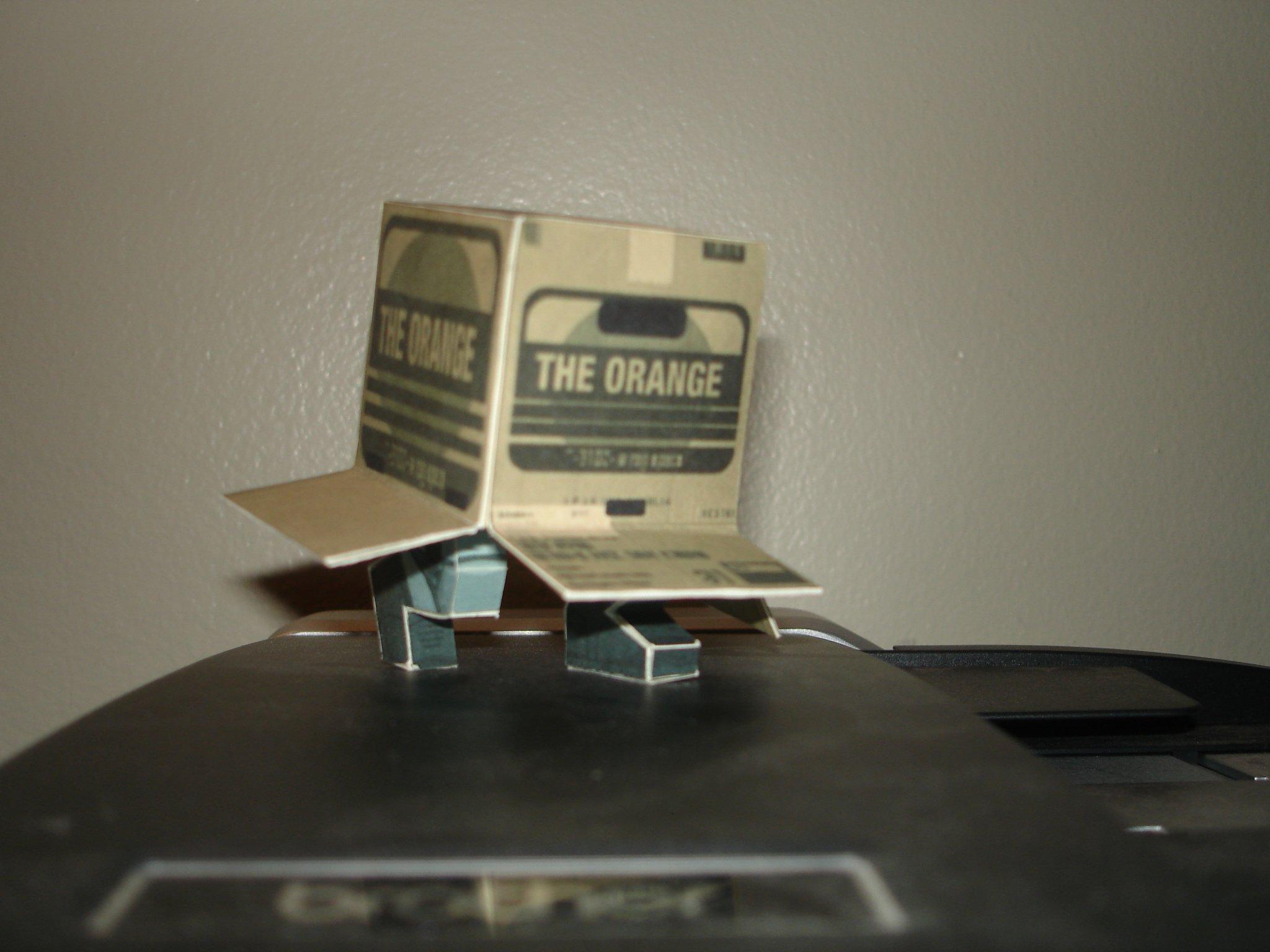 the orange solid snake in a box papercraft gematsu
